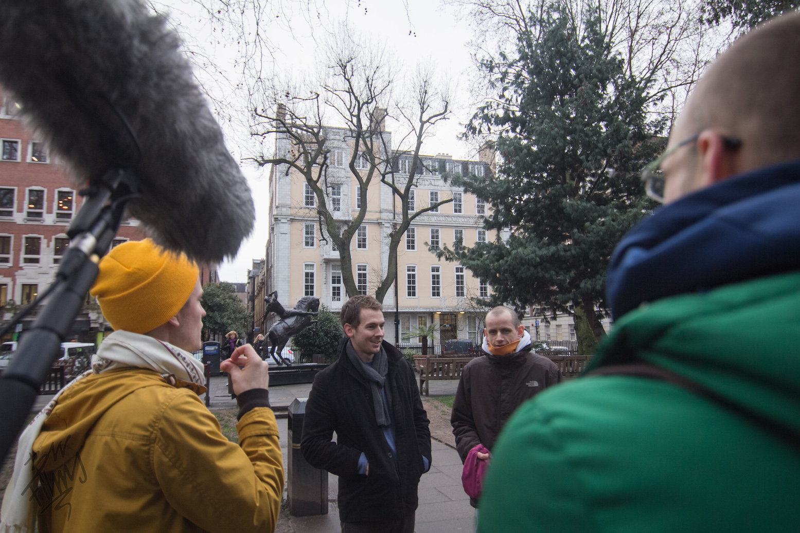 The crew films a scene with John Gould and Radha-Londonisvara Das