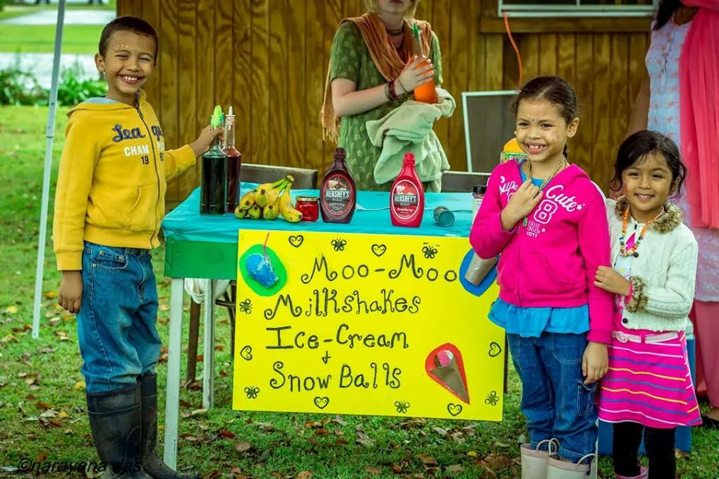 Children sell milkshakes and ice-cream made from New Talavana cows' milk